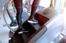 Woman on stair stepper at the gym