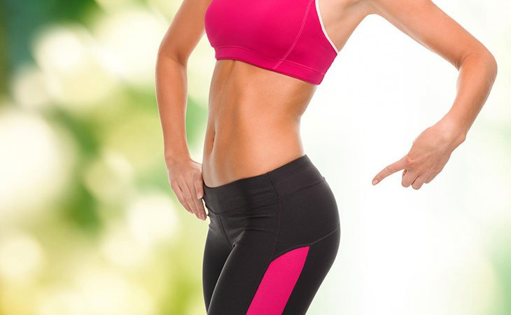 Woman Pointing At Her Fit Glute Working Out