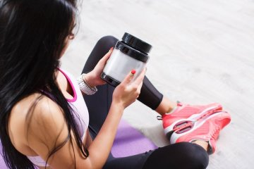 Woman Reading And Choosing BCAA