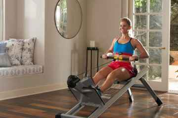 Woman Using Total Gym For Fitness