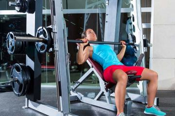 Woman Working Out on A Smith Machine For Fitness