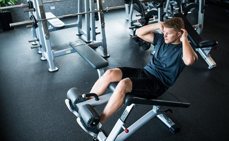 Man Working Out Sit Up Bench