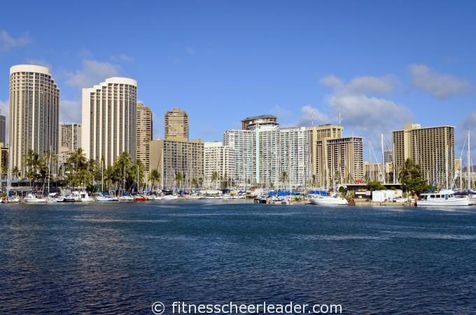 View of Honolulu Yacht Harbor from Magic Island with Honolulu buildings behind