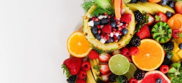 A mix of fruit against a white background.
