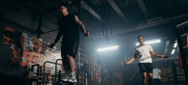 jumping rope exercise, two male working out