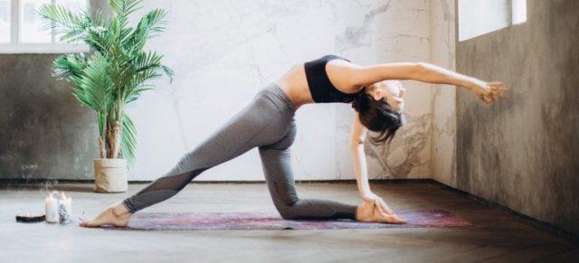 A woman doing yoga.