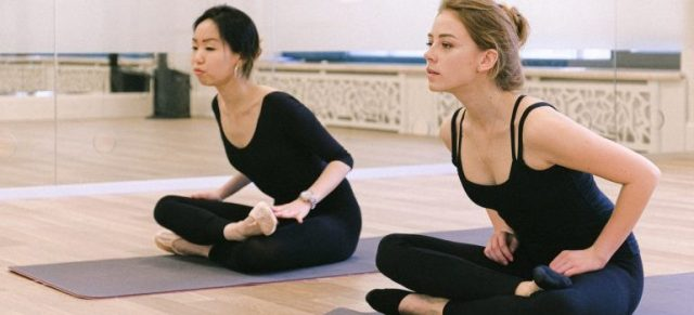 Girls doing yoga.