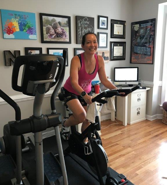 Sitting on my Sunny Fitness and Health spin bike, testing out my Peloton hack.