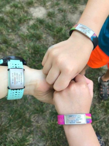 My wrist and the kids, wearing our RoadiDs.