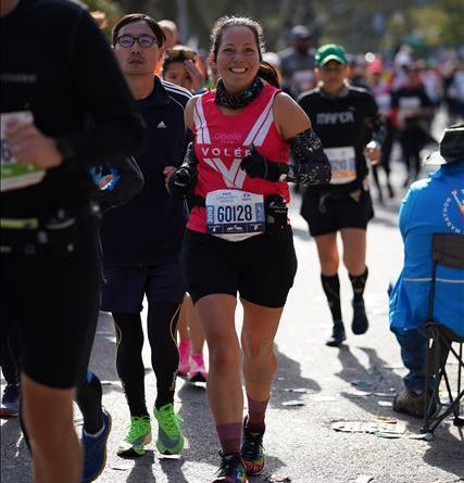 All smiles and wearing my red Oiselle Volee singlet during the New York marathon.