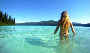 May is a Fresh New Start - woma walking in cristal clear water