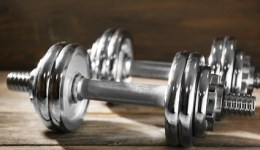 Big dumbbells on wooden background