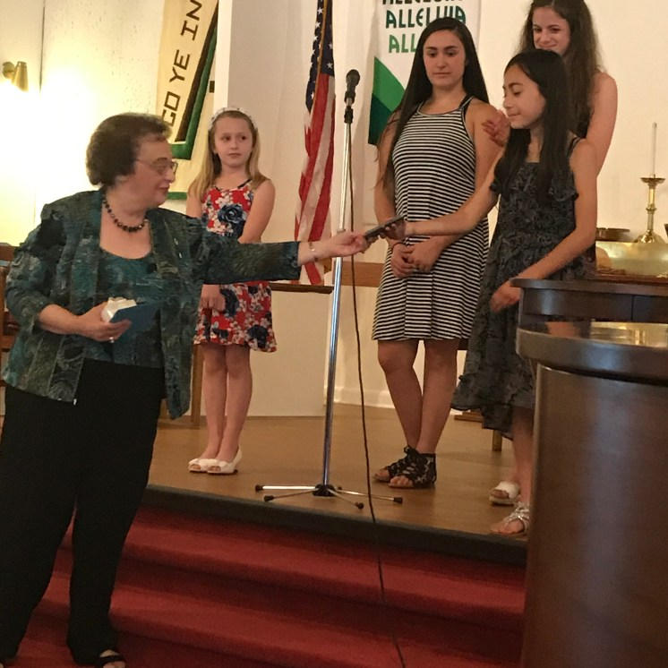 Mrs. Josephine Federico presents Maria with her NYSSMA medal; she earned a perfect score for her first time!