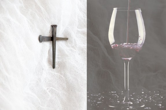 cross and wine glass with red wine