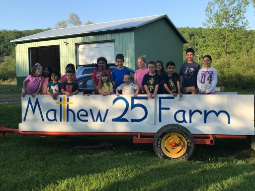 the Peanut Butter Club gathered in the Matthew 25 farm tractor