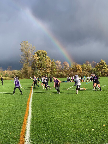 rainbow over the field hockey game