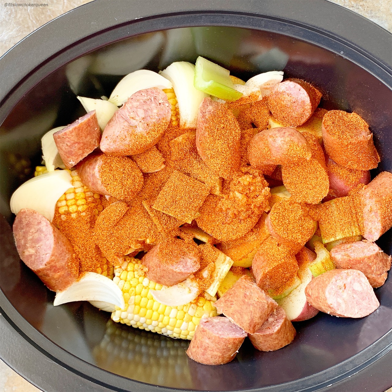 Cajun seasoning spices up this easy slow cooker low country boil. Simple yet packed full of flavor,  you can serve this Cajun dish year-round.