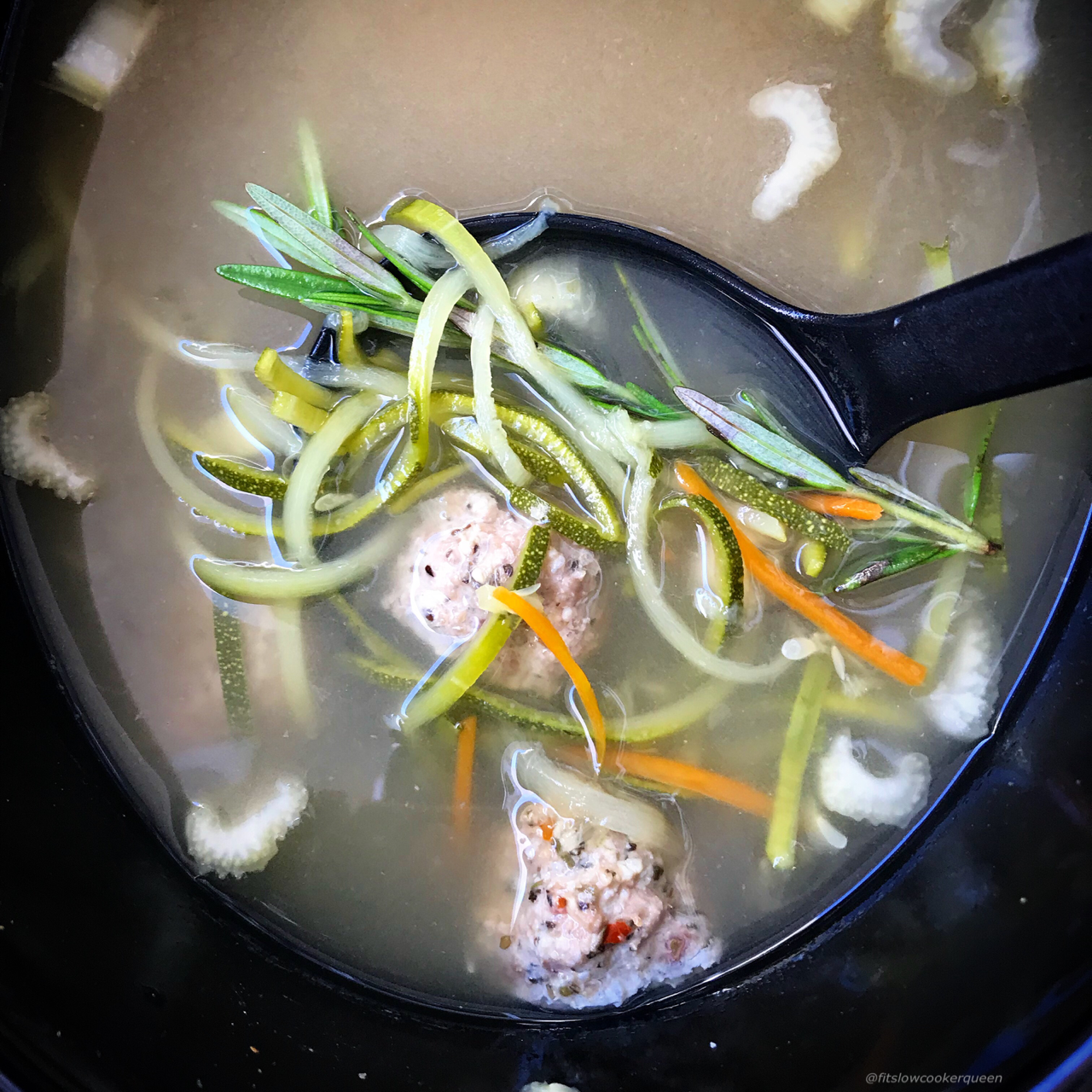 Zoodle soup! Slow cookers are meant to be used year-round. Zucchini zoodles and pre-made meatballs lighten up this soup that can be eaten year-round.