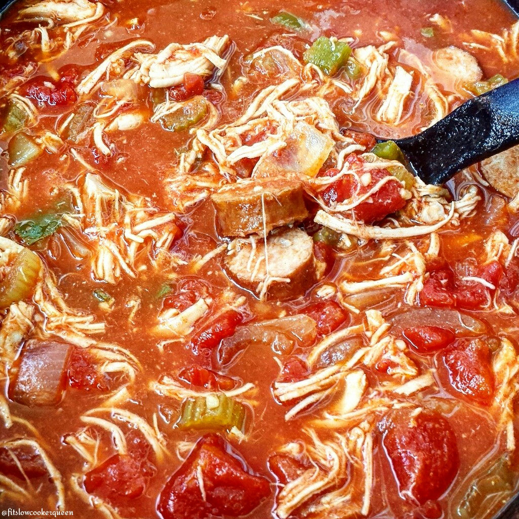 Cajun chicken and sausage cook together with tomatoes and a few spices in this light and healthy (paleo/whole30) creole-inspired slow cooker meal.