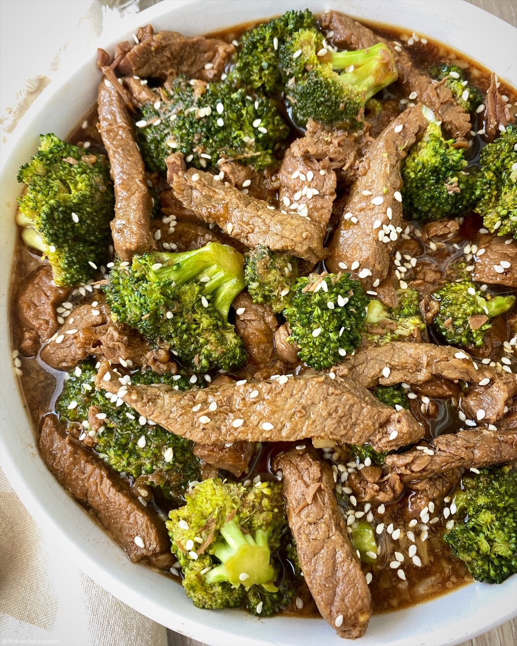 close up, side view of cooked beef & broccoli in a bowl