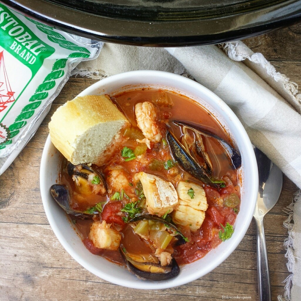 This healthy slow cooker version of a cioppino is packed with salted cod, scallops, mussels and shrimp. Both paleo & whole30 it's the perfect seafood pot!