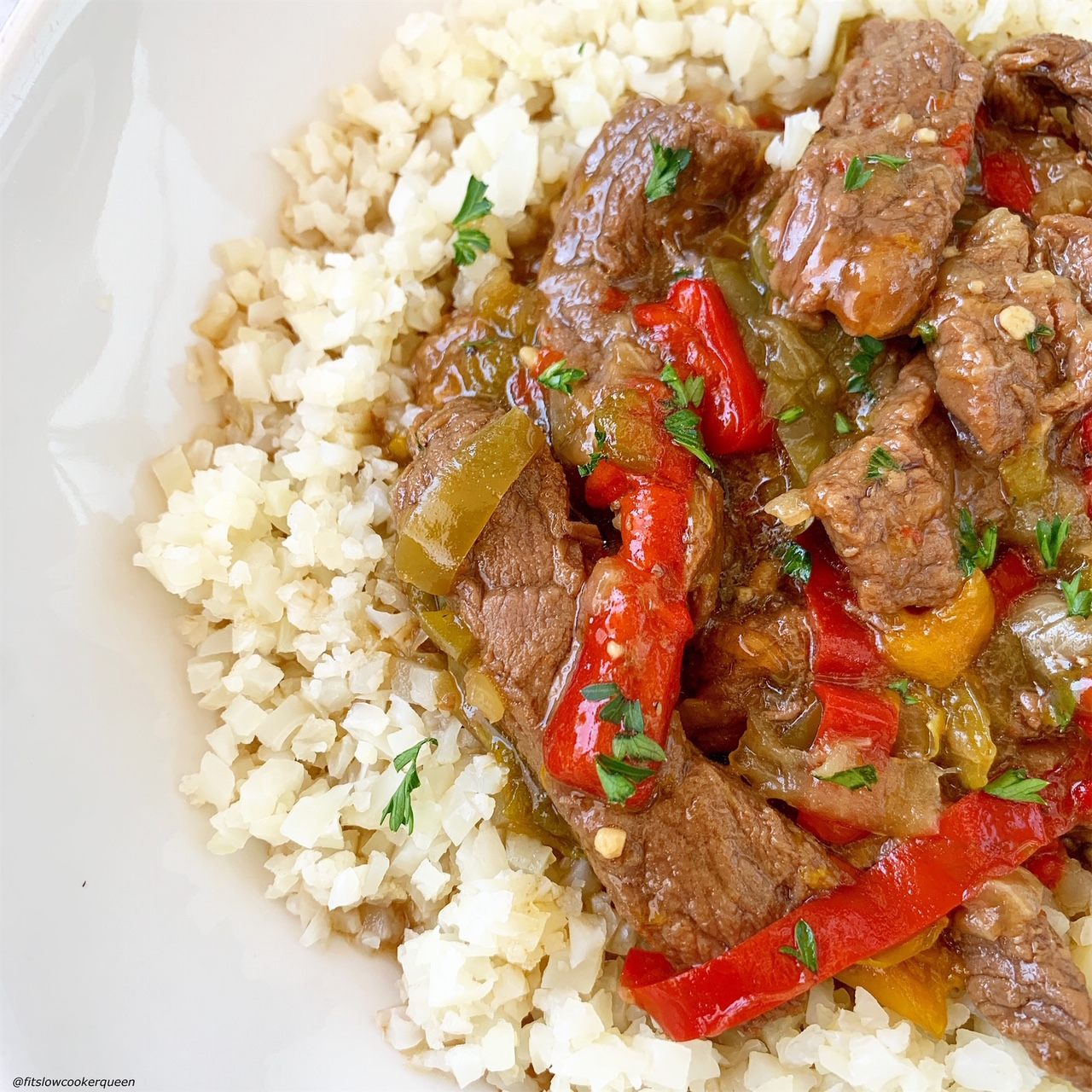 another pic cooked pepper steak placed with cauliflower rice
