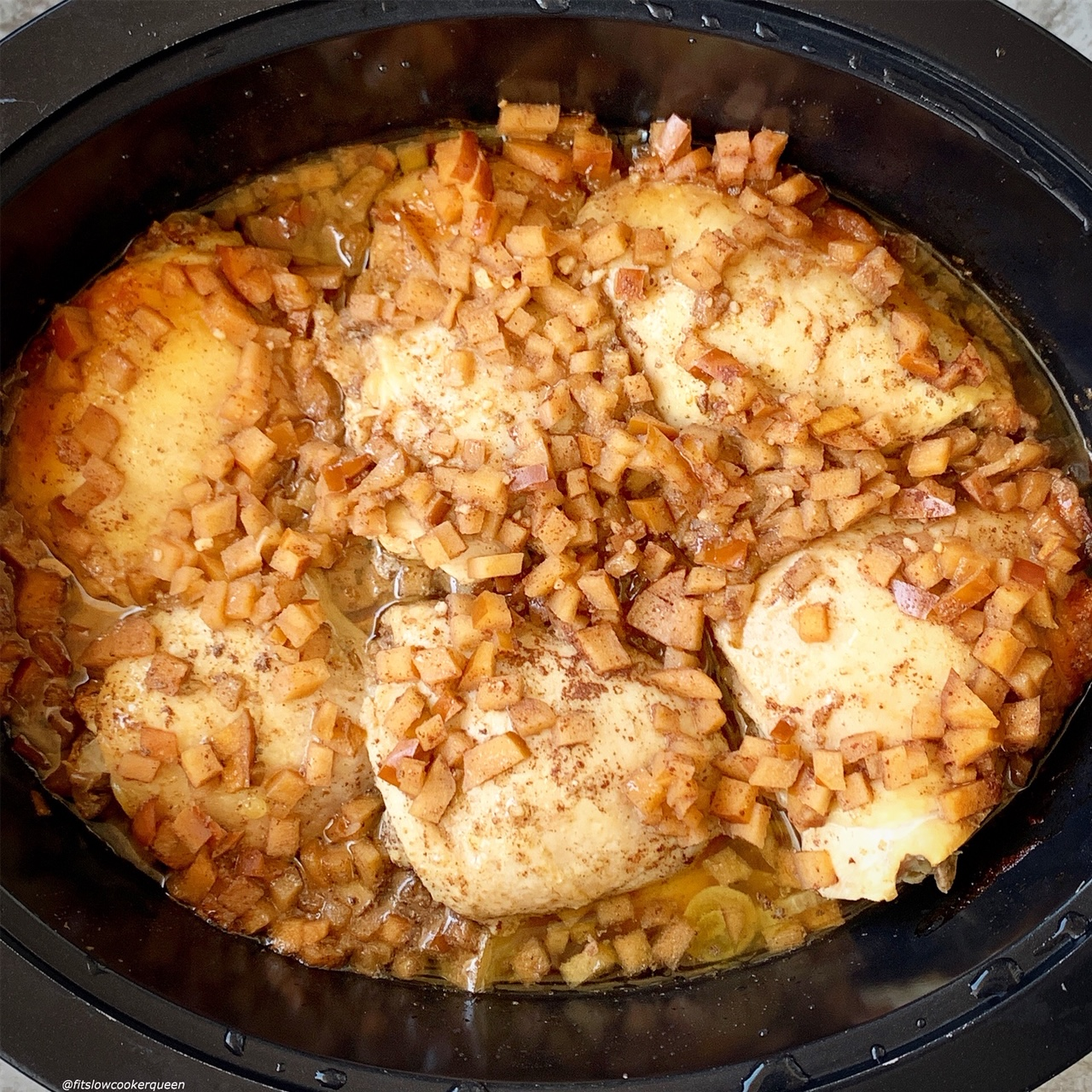 after pic of cooked chicken in the slow cooker for Slow Cooker or Instant Pot Chicken with Apples & Honey (