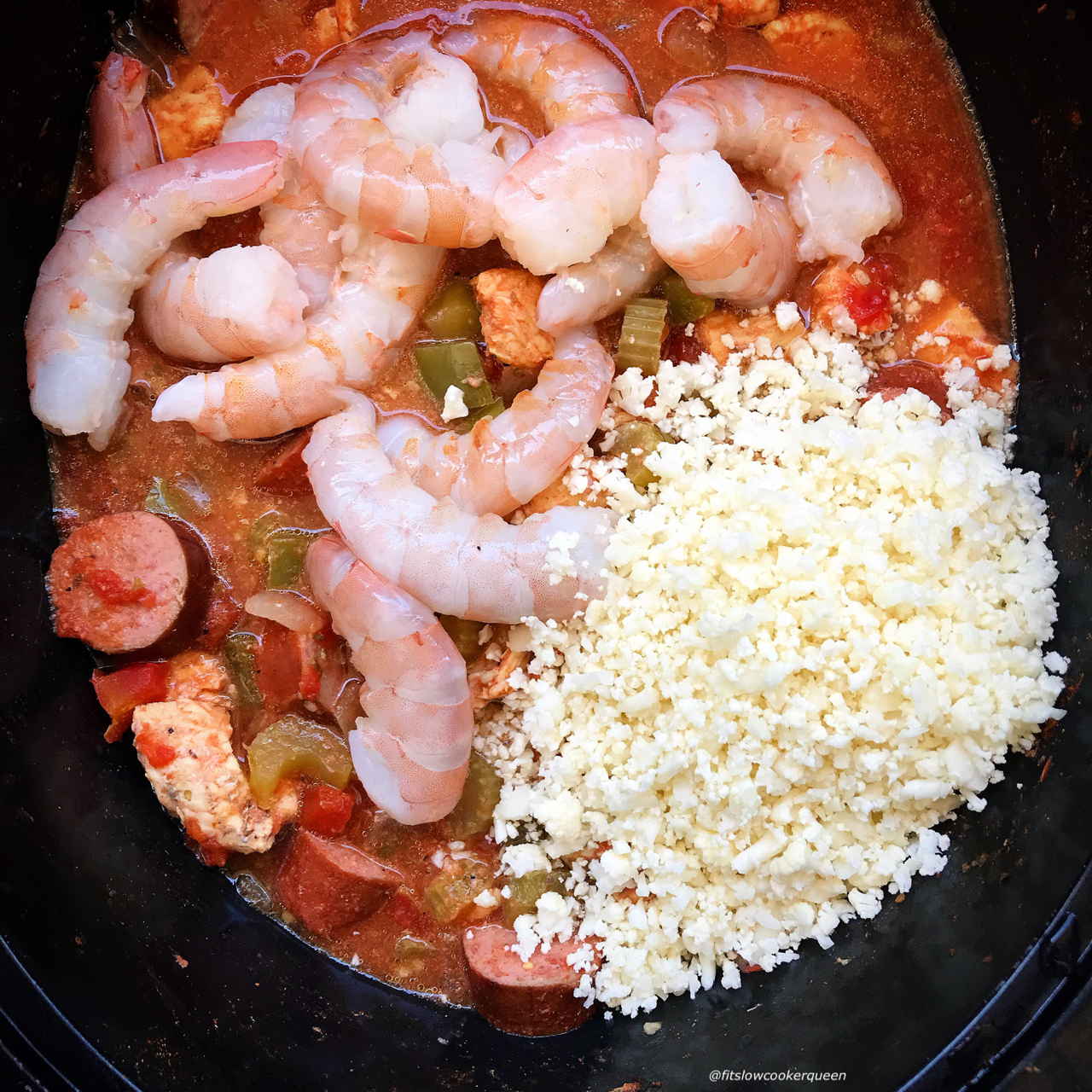 Packed with Creole and Cajun flavors, this easy slow cooker jambalaya recipe uses cauliflower rice to make it low-carb, whole30, and paleo.