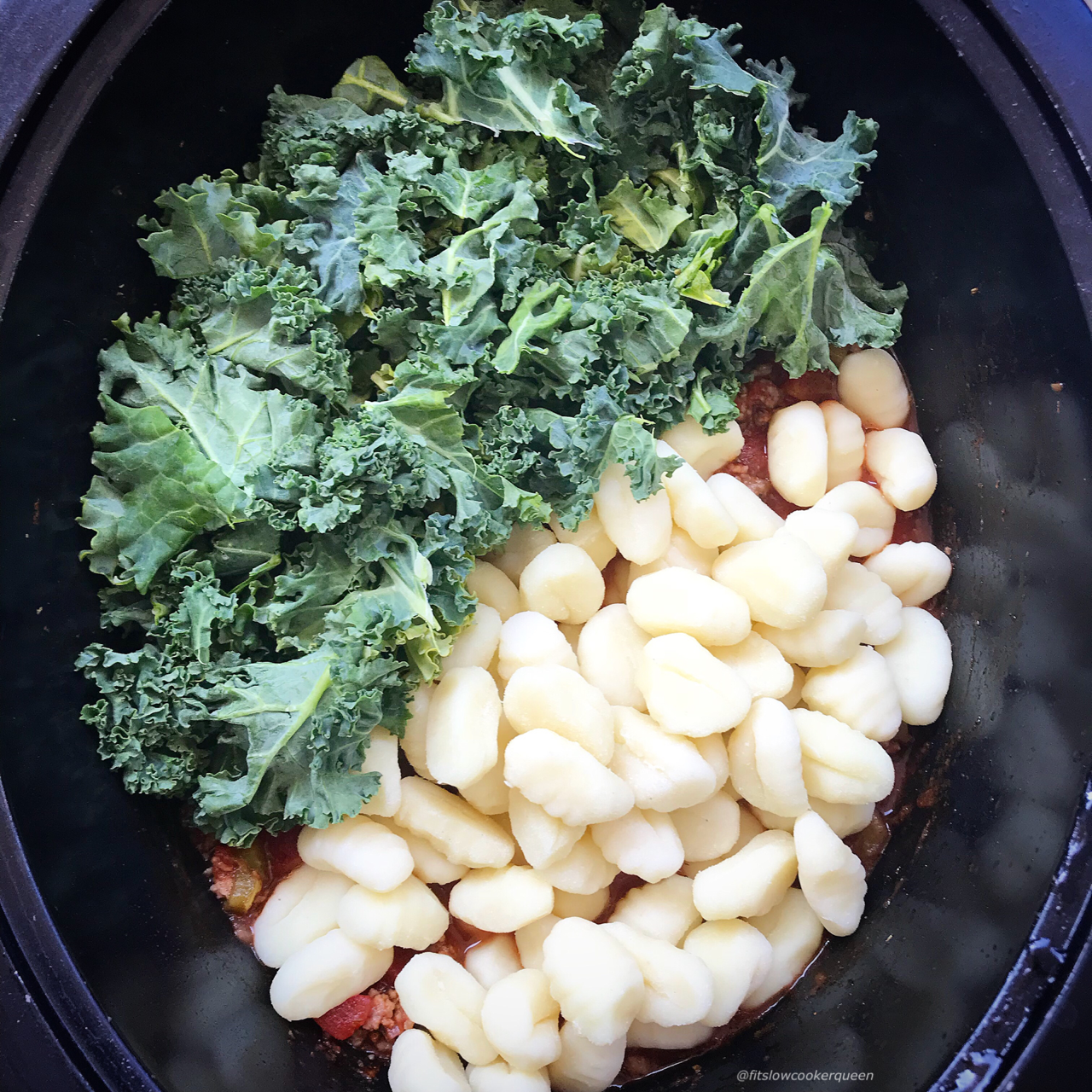 Gnocchi in the slow cooker? Of course! Gnocchi, sausage, and kale cook in a tomato sauce in this simple and hearty slow cooker recipe. Slow cooker comfort food at it's finest.