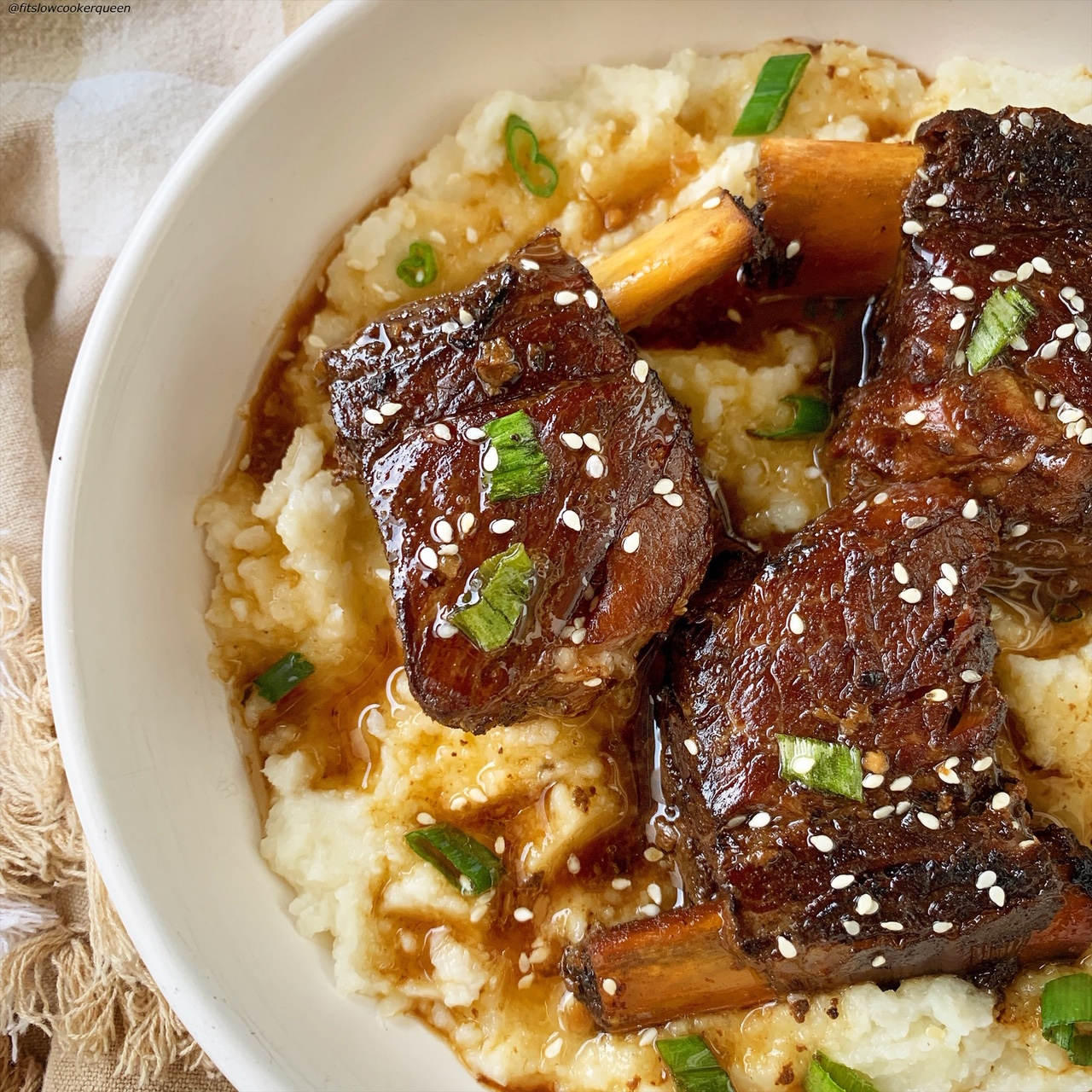 plated korean style short ribs served over mashed cauliflower