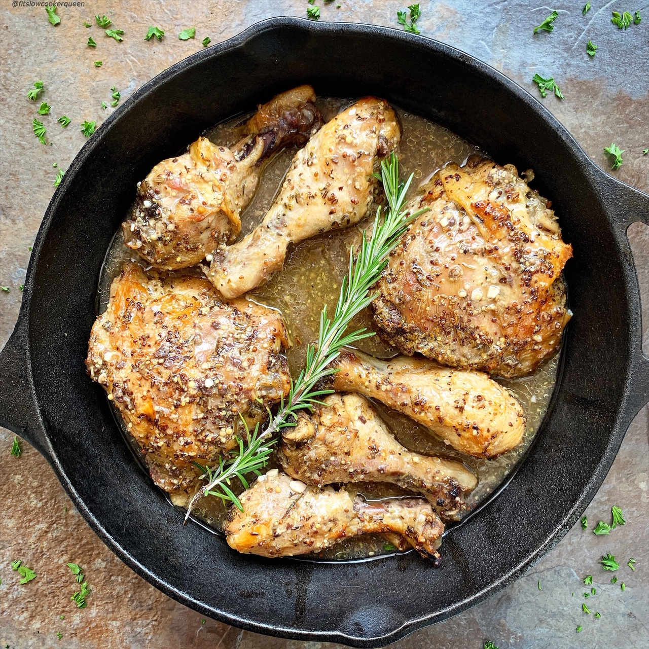 A homemade rosemary Dijon sauce cooks on top of your favorite cut of chicken in this easy low-carb, paleo, and whole30 slow cooker or electric pressure cooker recipe.