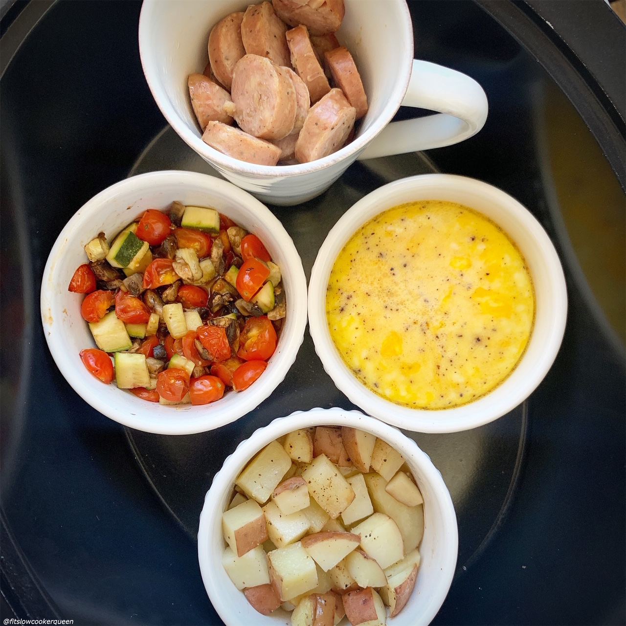 cooked food in coffee mugs & ramekins to cook for Slow Cooker Healthy Fry Up Breakfast (Paleo,Whole30)