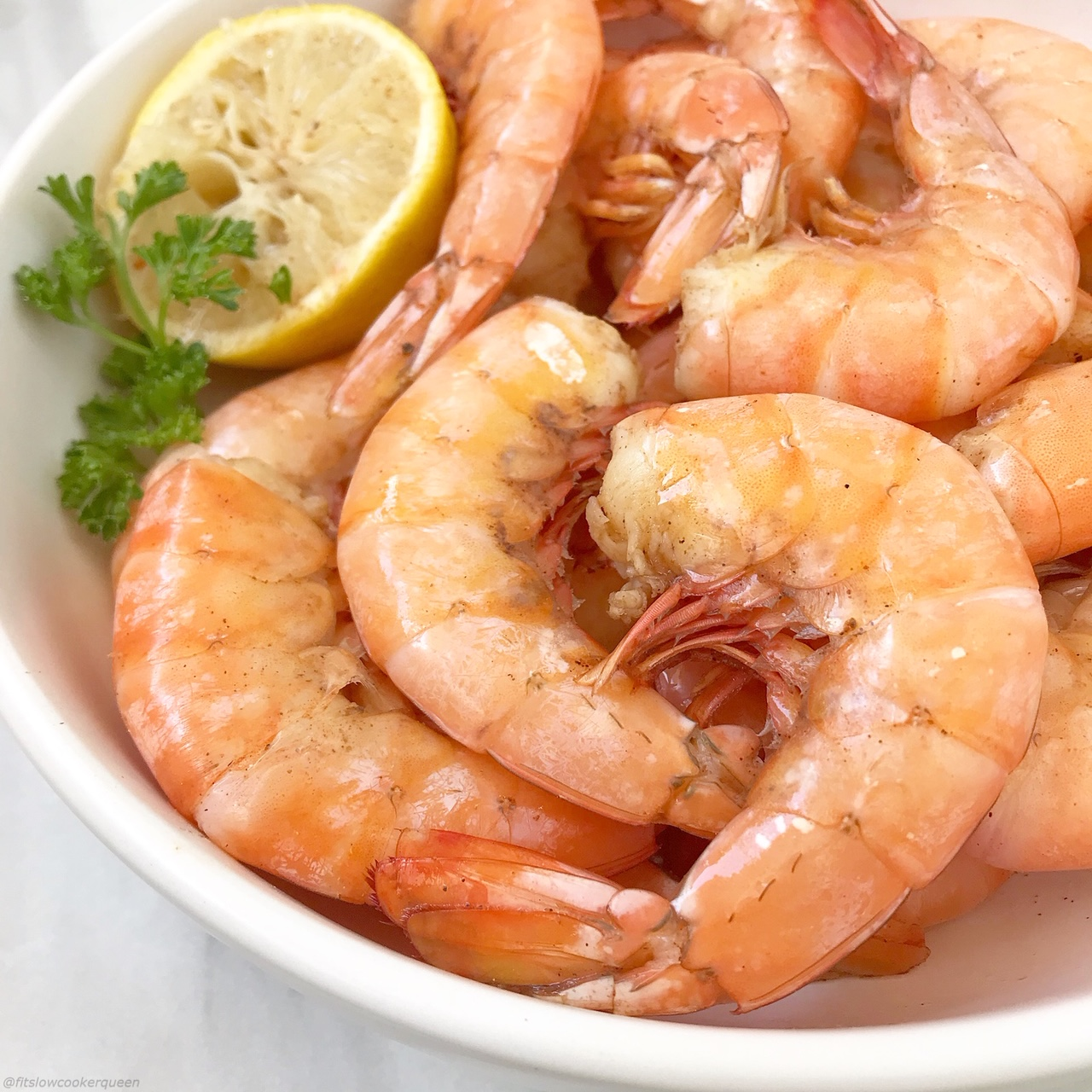 Peel and Eat shrimp are an easy, healthy appetizer or snack. This slow cooker version uses a homemade Old Bay seasoning and cooks in just an hour.