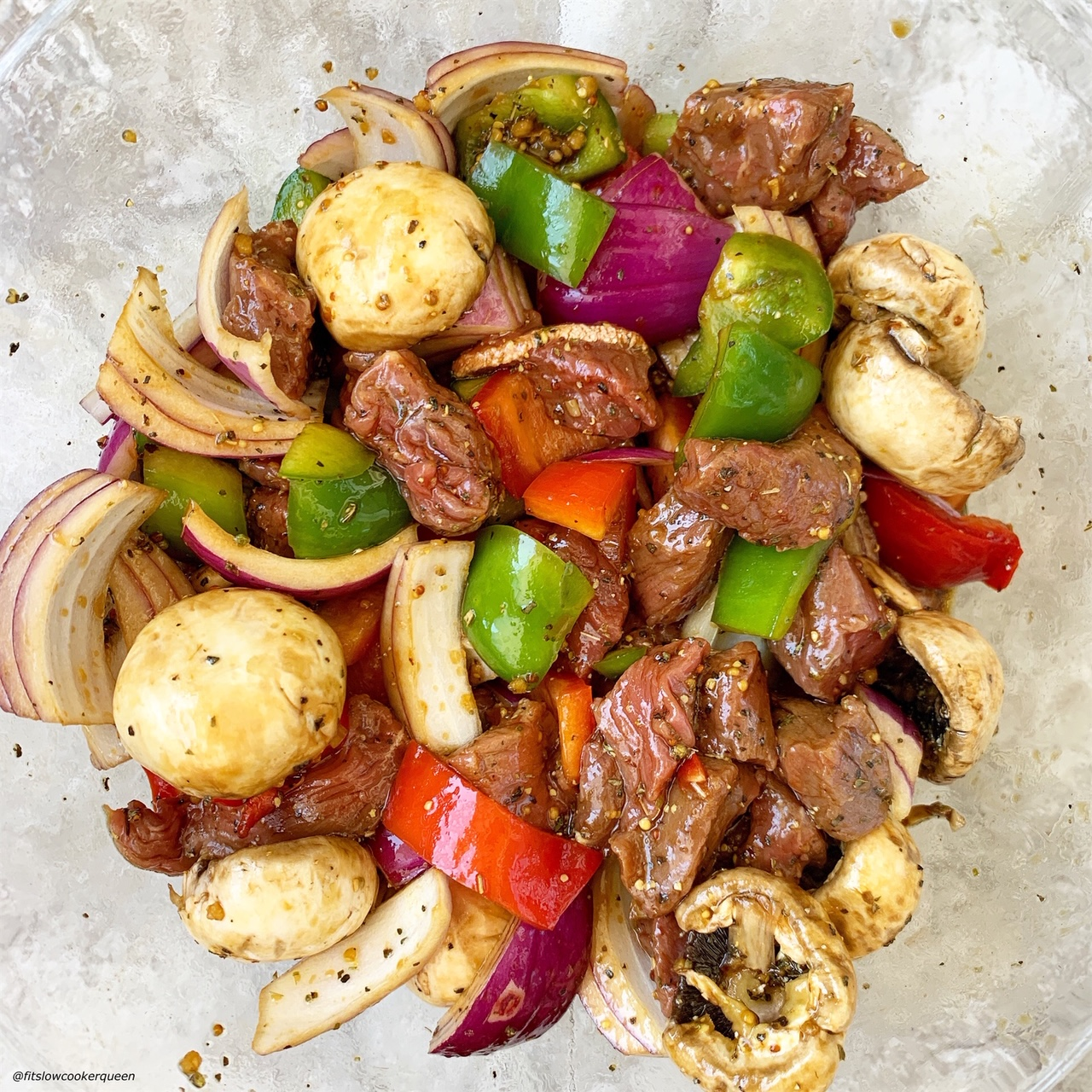 marinade on top of meat & vegetables for Sheet Pan Deconstructed Beef Kebabs (Low-Carb, Paleo, Whole30)