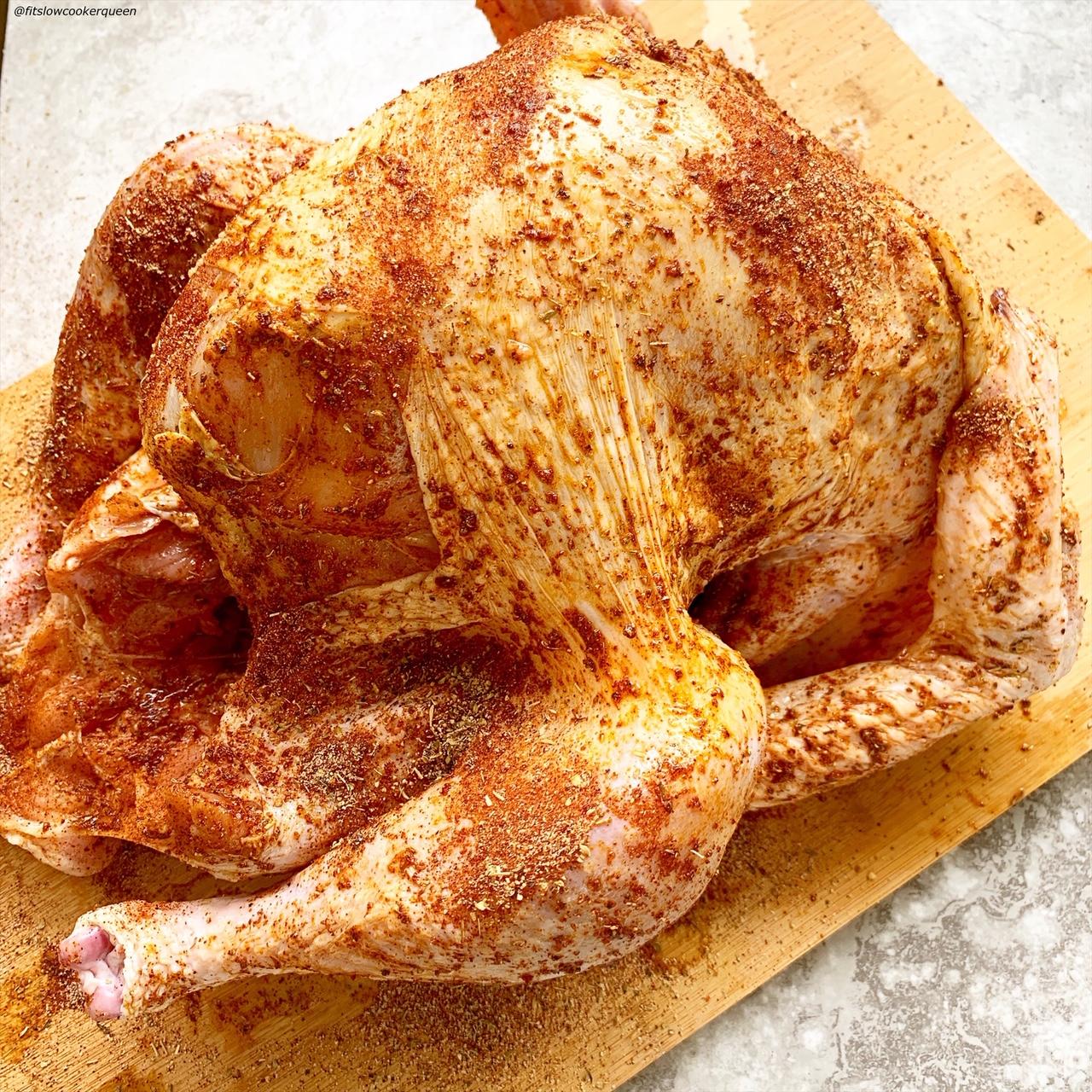 raw whole turkey seasoned with homemade rotisserie seasoning