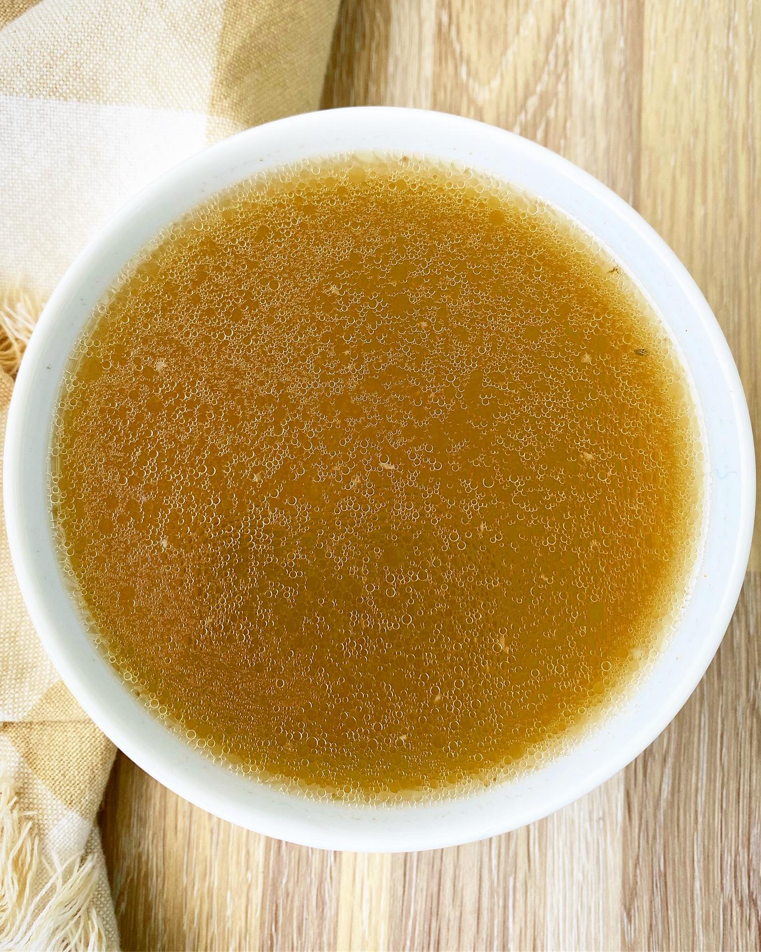 warmed bone broth in a bowl