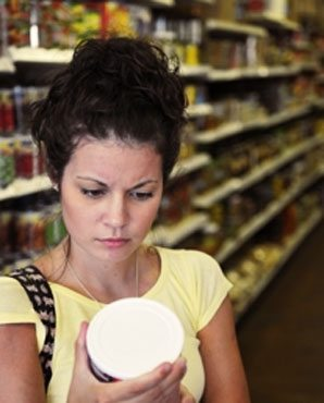 woman-looking-at-nutrition-label