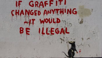 """Writing on a wall says: """"If graffiti changed anything - it would be illegal"""""""