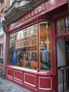 Shopfront with violins in the window.