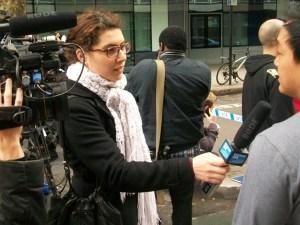 A TV reporter interviews a witness.