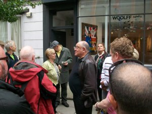 Man addressing people on guided walk.