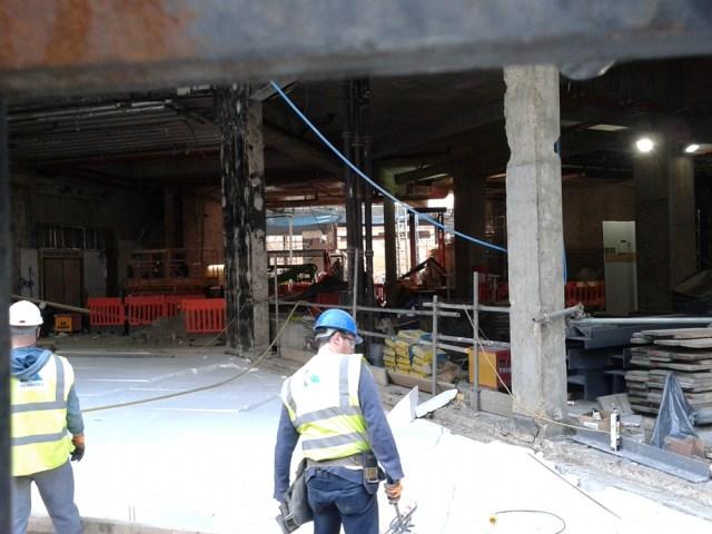 Demolition site underneath block of flats.