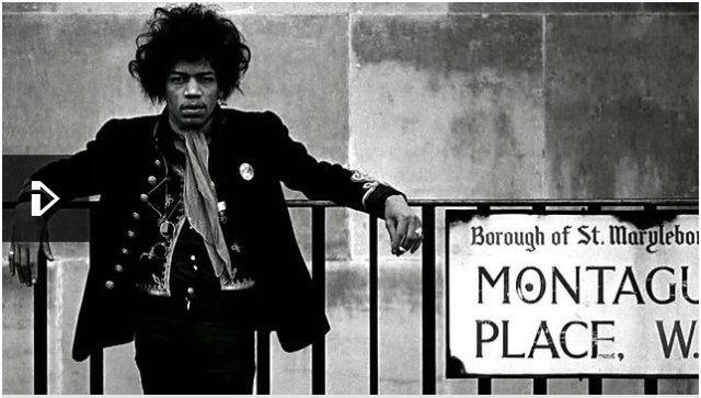 Hendrix standing against railings in Montagu Place, Borough of Marylebone.