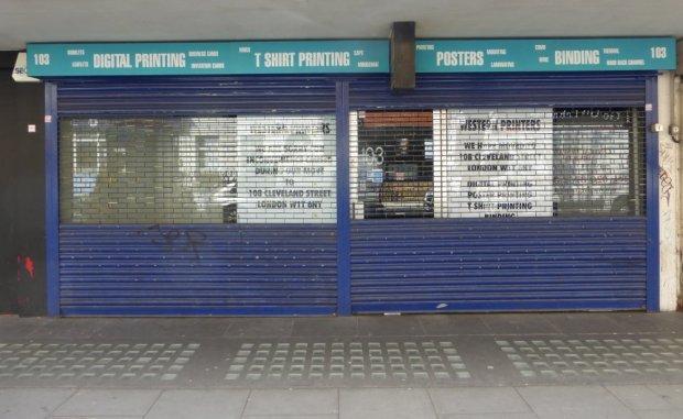 Roller shutters down on shopfront.