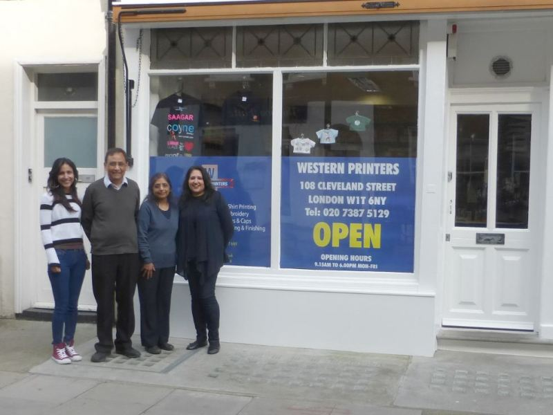 Staff standing outside shop.