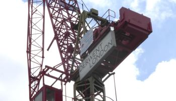 Crane with sign.