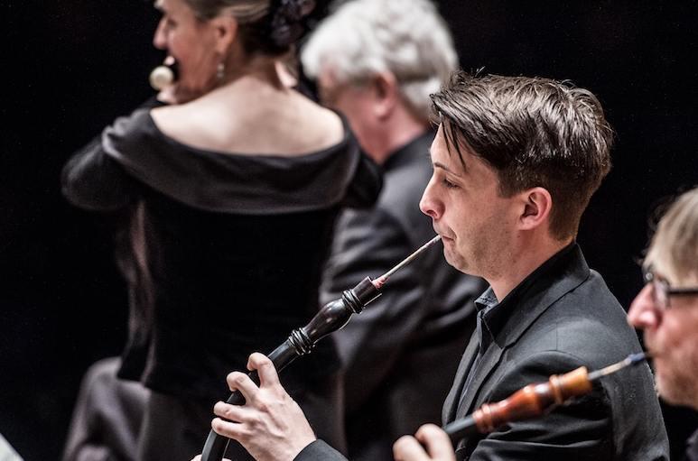 Man playing oboe.