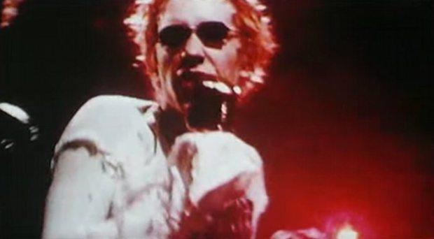 Johnny Rotten aka John Lydon, singing.