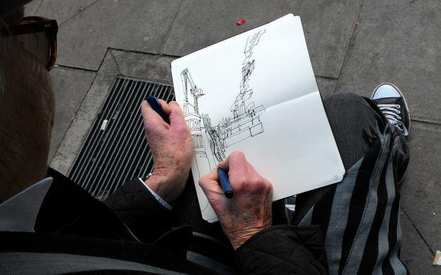 Artist at work drawing.