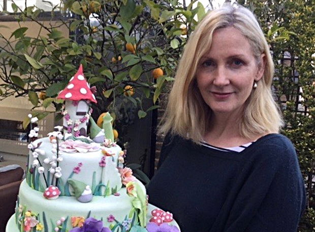 Woman holding a big cake.